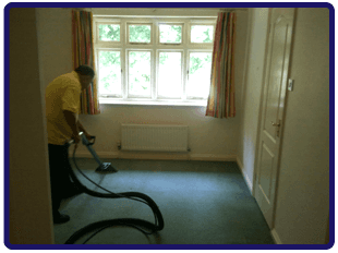 Man deep cleaning a carpet