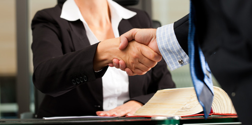 Attorney shaking hands with clients in La Crosse, WI