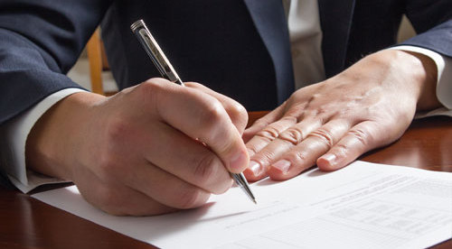 Client signing law documents in La Crosse, WI