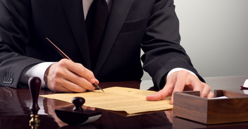 lawyer signing law documents in La Crosse, WI