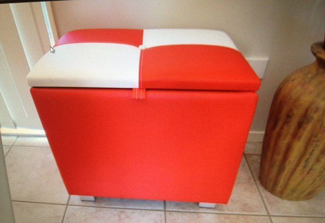 Red and white upholstery for a stool