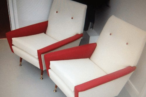View of red and white upholstery for sofa chair