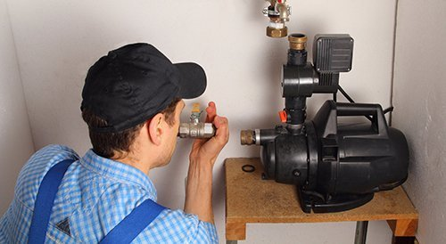 Professional repairing the pump
