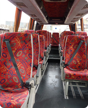 The inside of a Lords coach with red seats