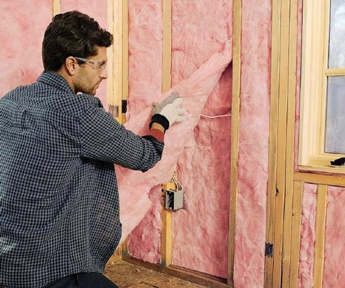 Thermally insulating house by a man