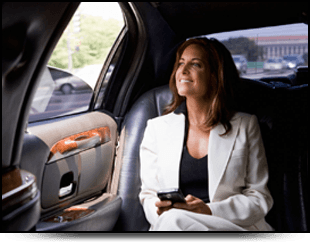 Lady sitting in the back of a leather upholstered car