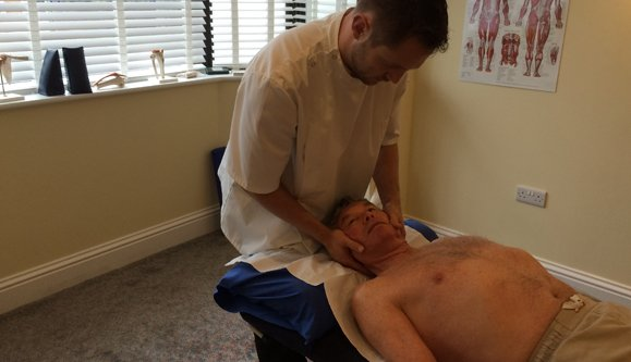 man treating for neck pain