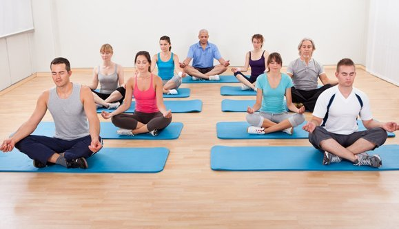 men and women during yoga session