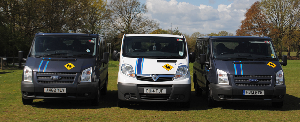 3 minibuses parked