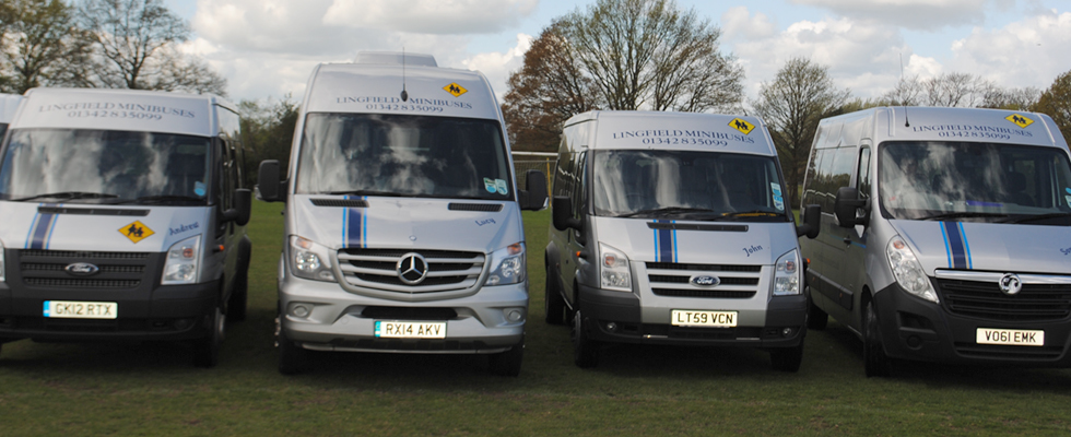 4 silver coloured minibuses
