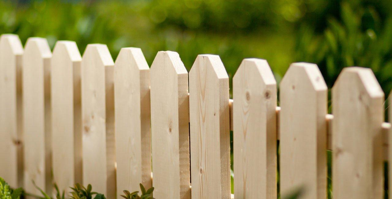 Pale wood picket fence