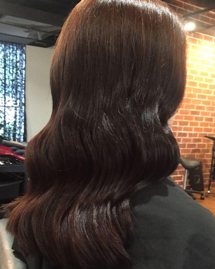 curled brown hair
