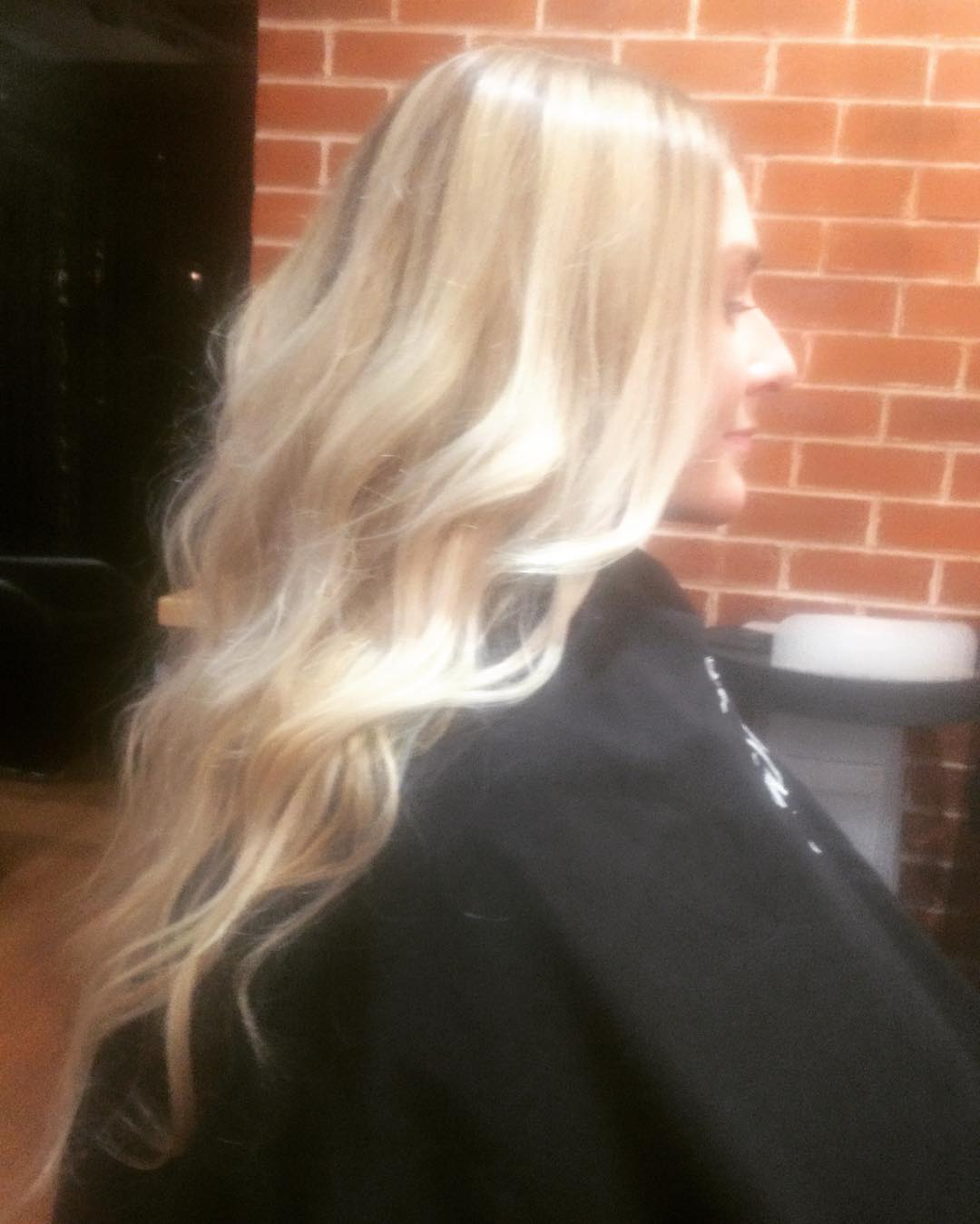 curled bleached blond hair