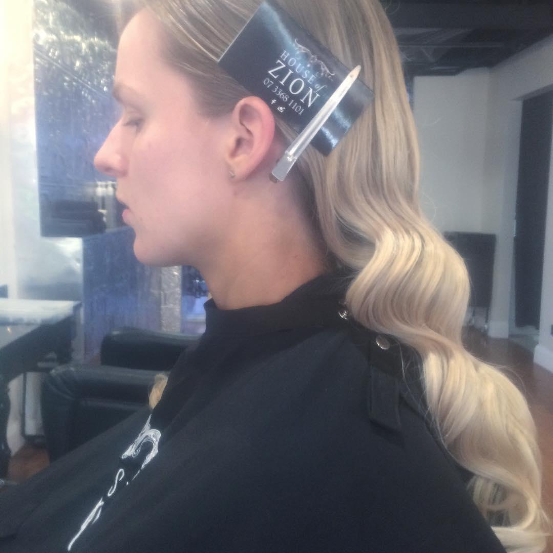 curled blond hair
