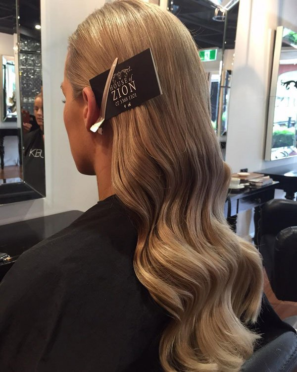 blonde curled hair from behind