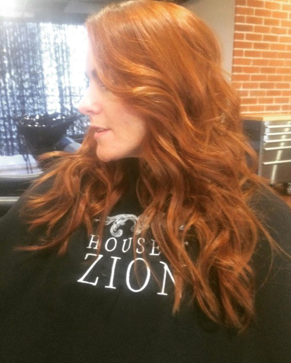 curled brown red hair