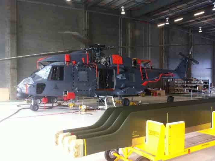 Helicopter being repaired