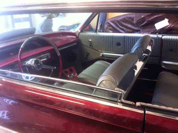 New upholstery being installed in the car