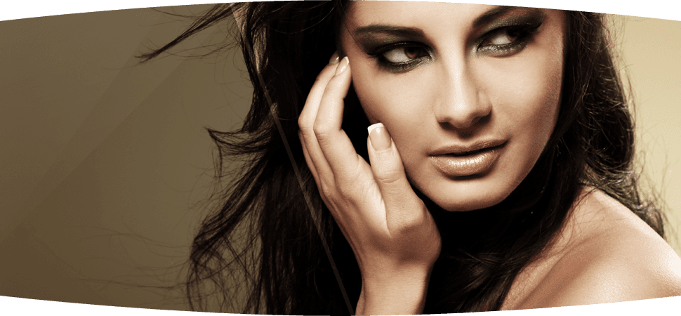 Beautiful brunette girl with French manicured nails and smoky eye make-up