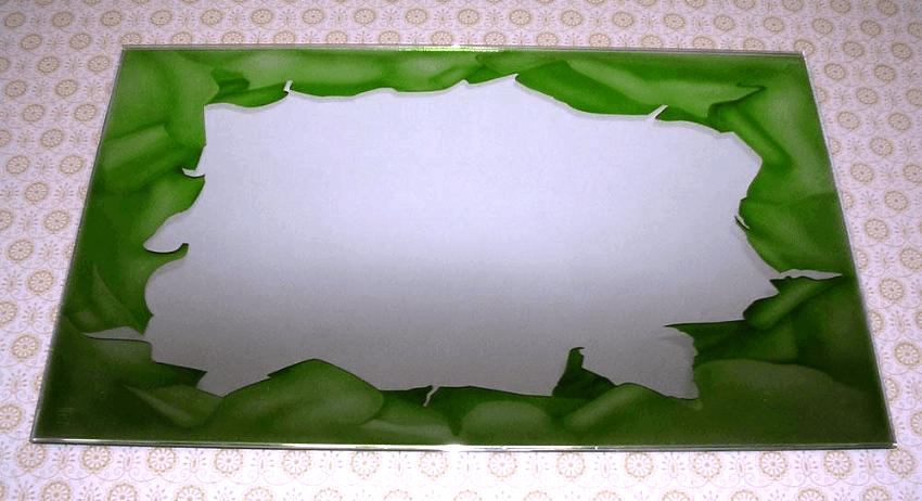 Specchio decorato con effetto carta strappata
