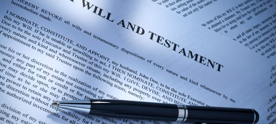 A black and silver pen on top of a Last Will and Testament document