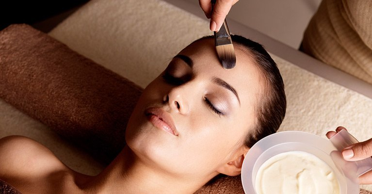 tropaz hair designs and beauty woman getting facial