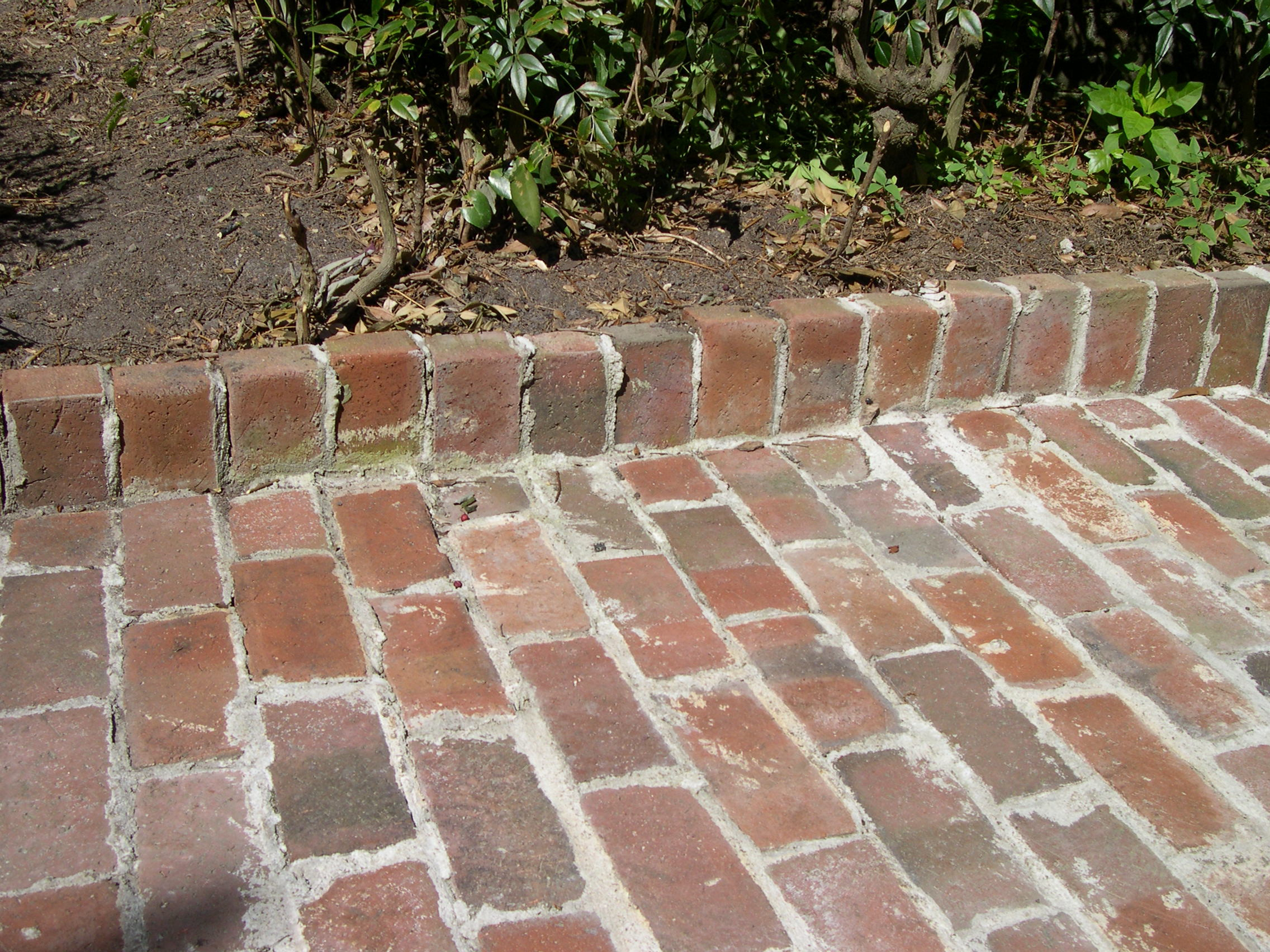 Poor installation, no base, caused for bricks to buckle.