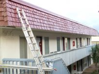 Building in the process of being repaired and painted by Lions Painting LLC workers in Honolulu, HI