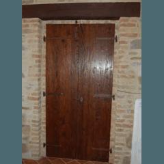 Porta asciata anticata in Castagno massello