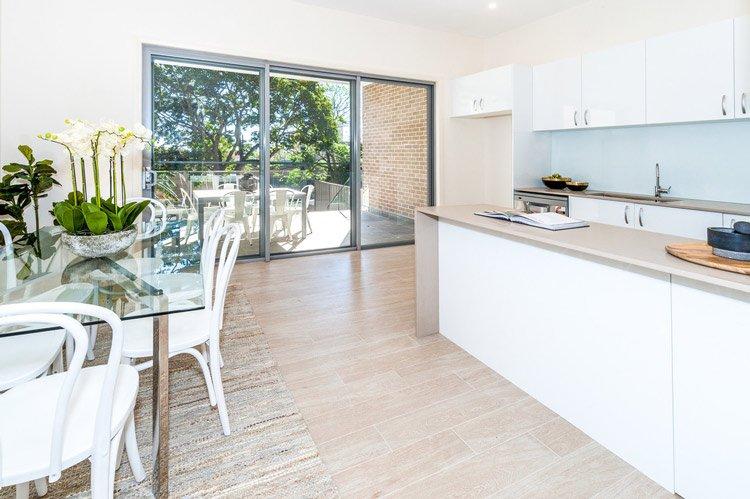 white kitchen with sliding glass door
