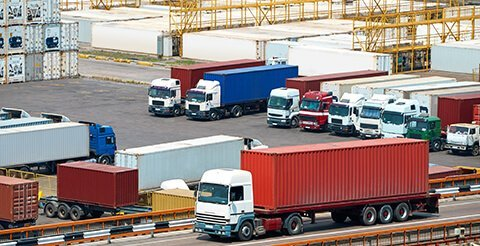 Truck transportation containers from ship near sea