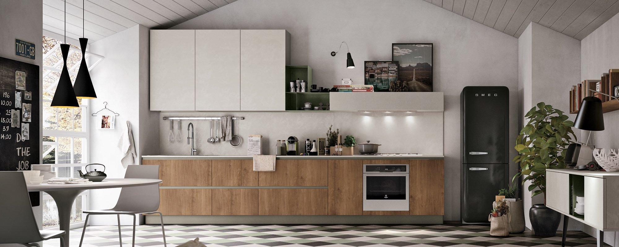 vista frontale di una cucina con tavolo in mezzo alla stanza
