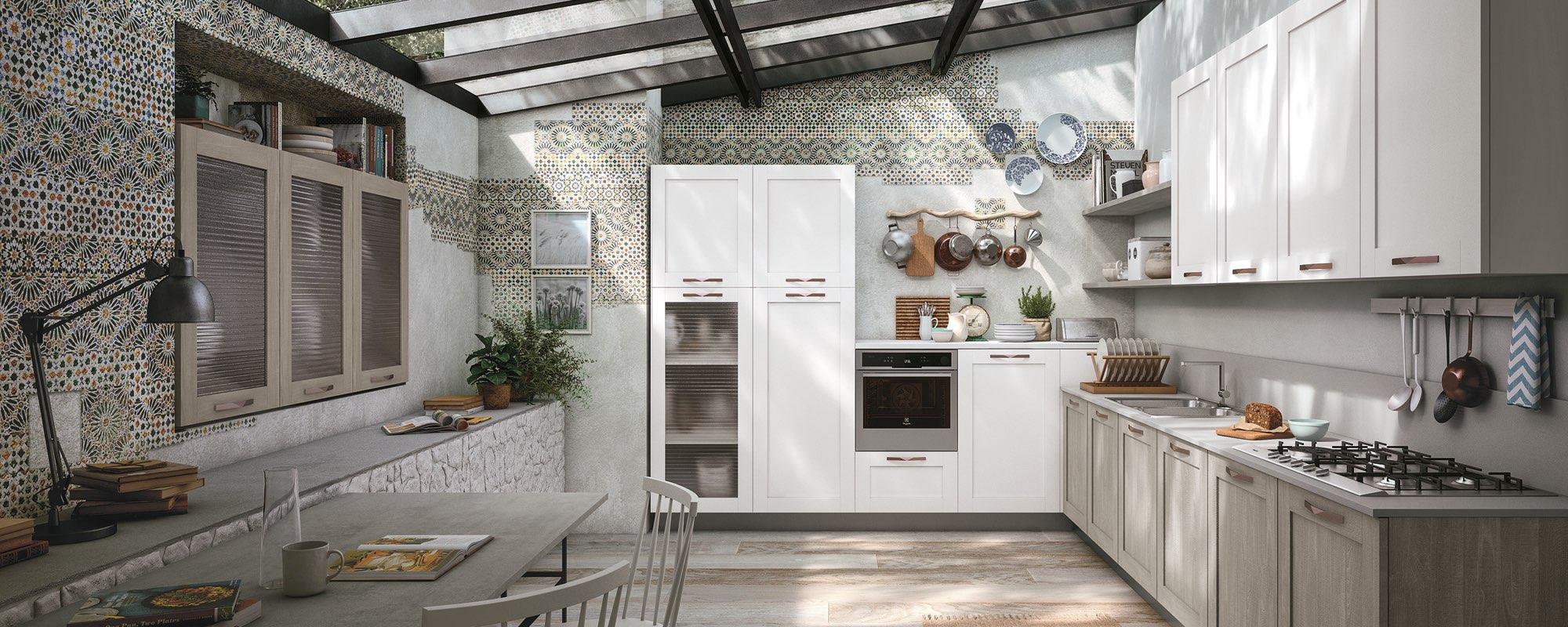 un ambiente con cucina e salotto e arredamenti