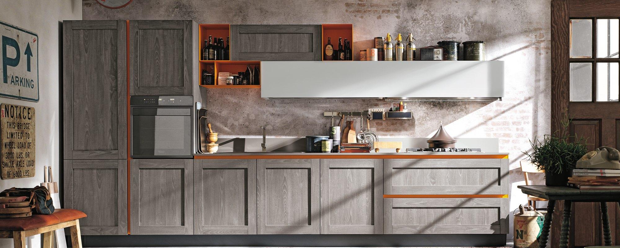 vista frontale di una cucina moderna in legno con mobili in legno