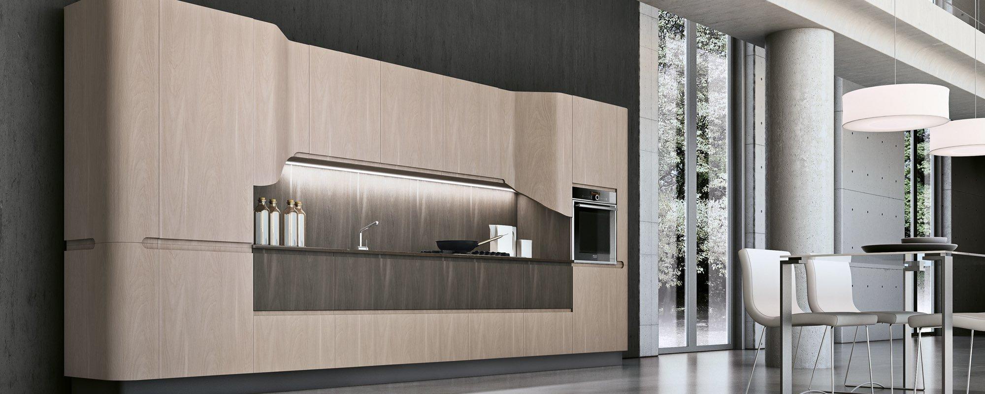 vista laterale di cucina moderna in legno a scomparsa - BRING