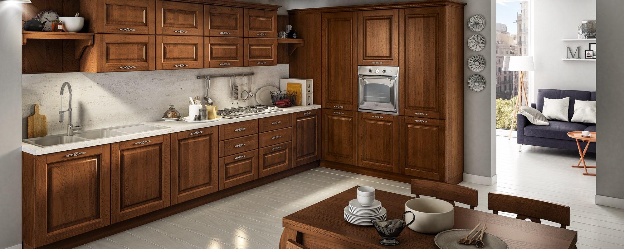 vista angolare di una cucina classica in legno con arredo - SATURNIA