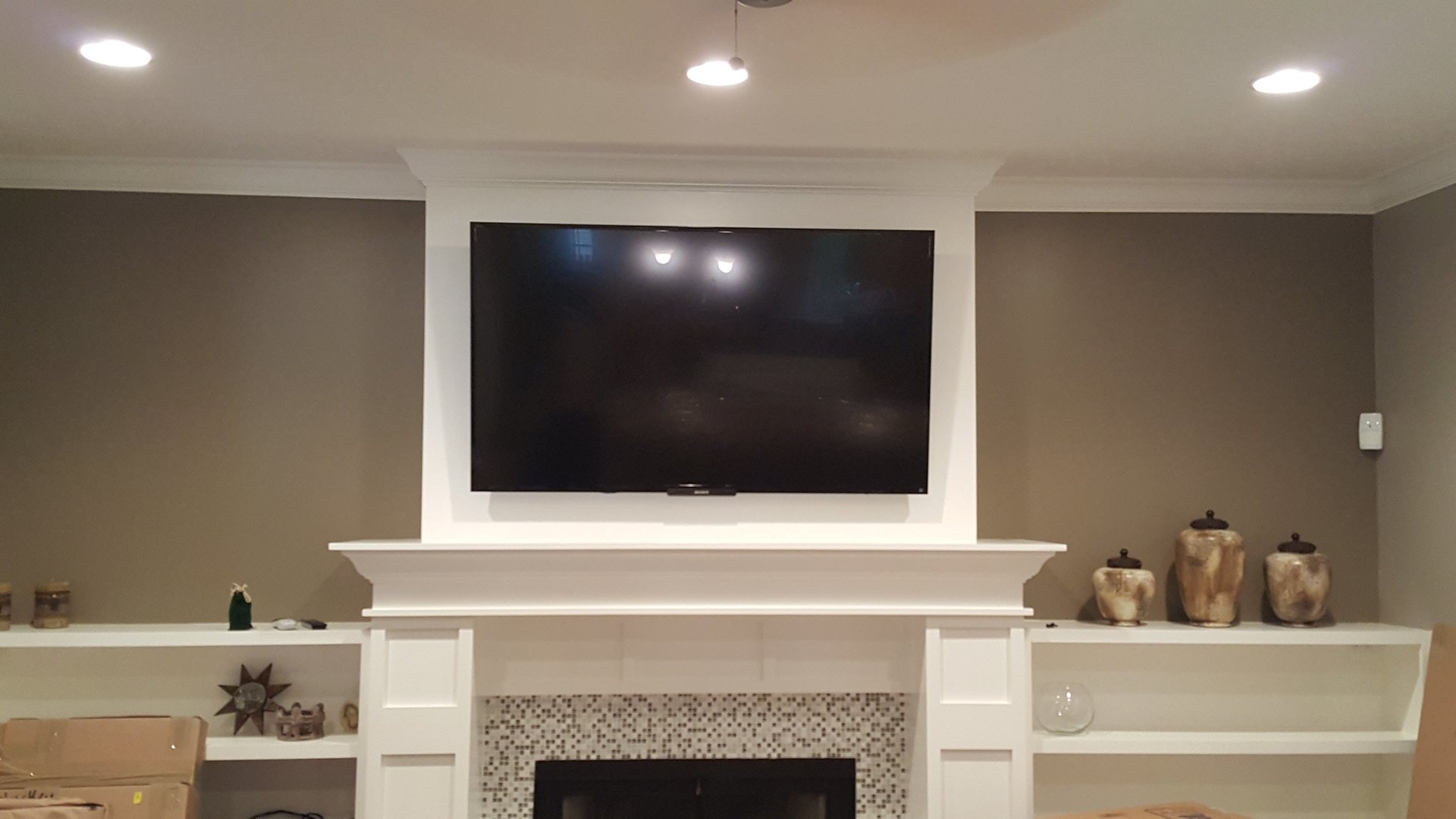 TV Wall Mounting & TV Fireplace Installation & Setup