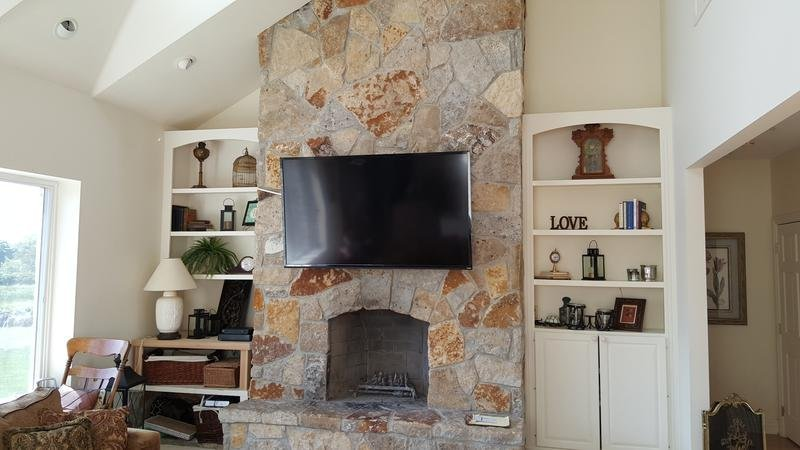 tv over fireplace, fireplace tv mount