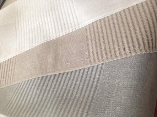 esempi di tessuti bianco, grigio e beige