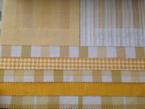 esempi di tessuti di color giallo e bianco