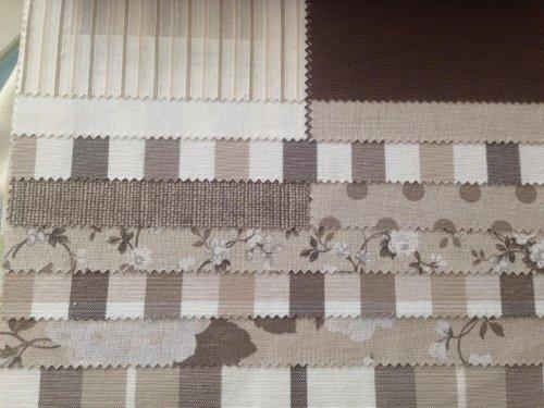 esempi di tessuti di color bianco e marrone