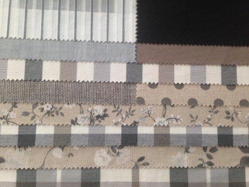 esempi di tessuto di colore grigio, bianco e beige con disegni