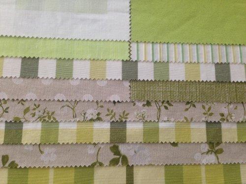 esempi di tessuti di  color verde bianco e giallo