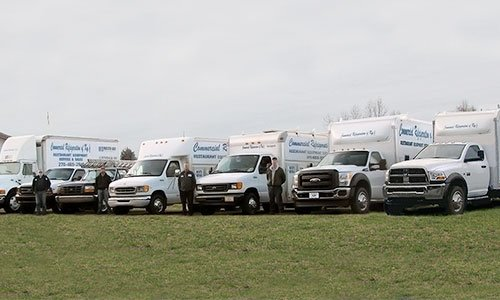 Delivery refrigerated trucks with employees in Campbellsville