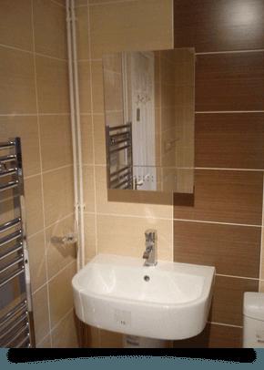 a sink and bathroom mirror in a stylish bathroom