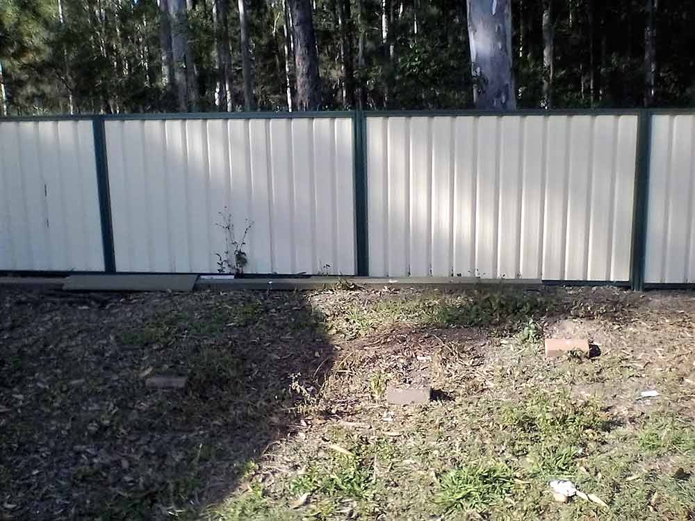 white and green fence