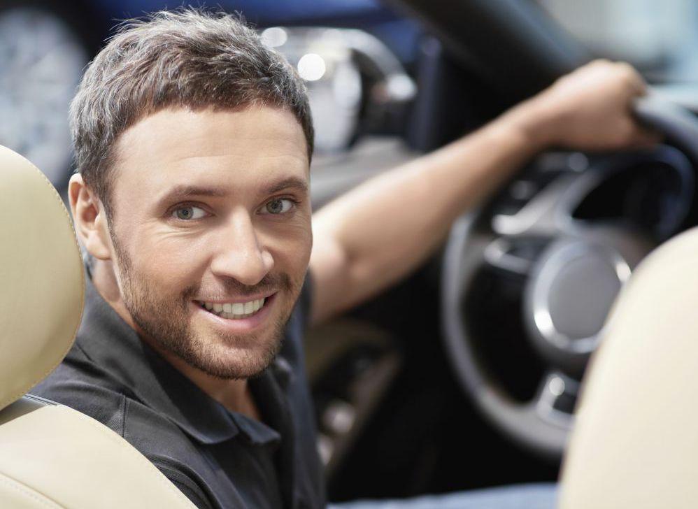 Smiling man in his car