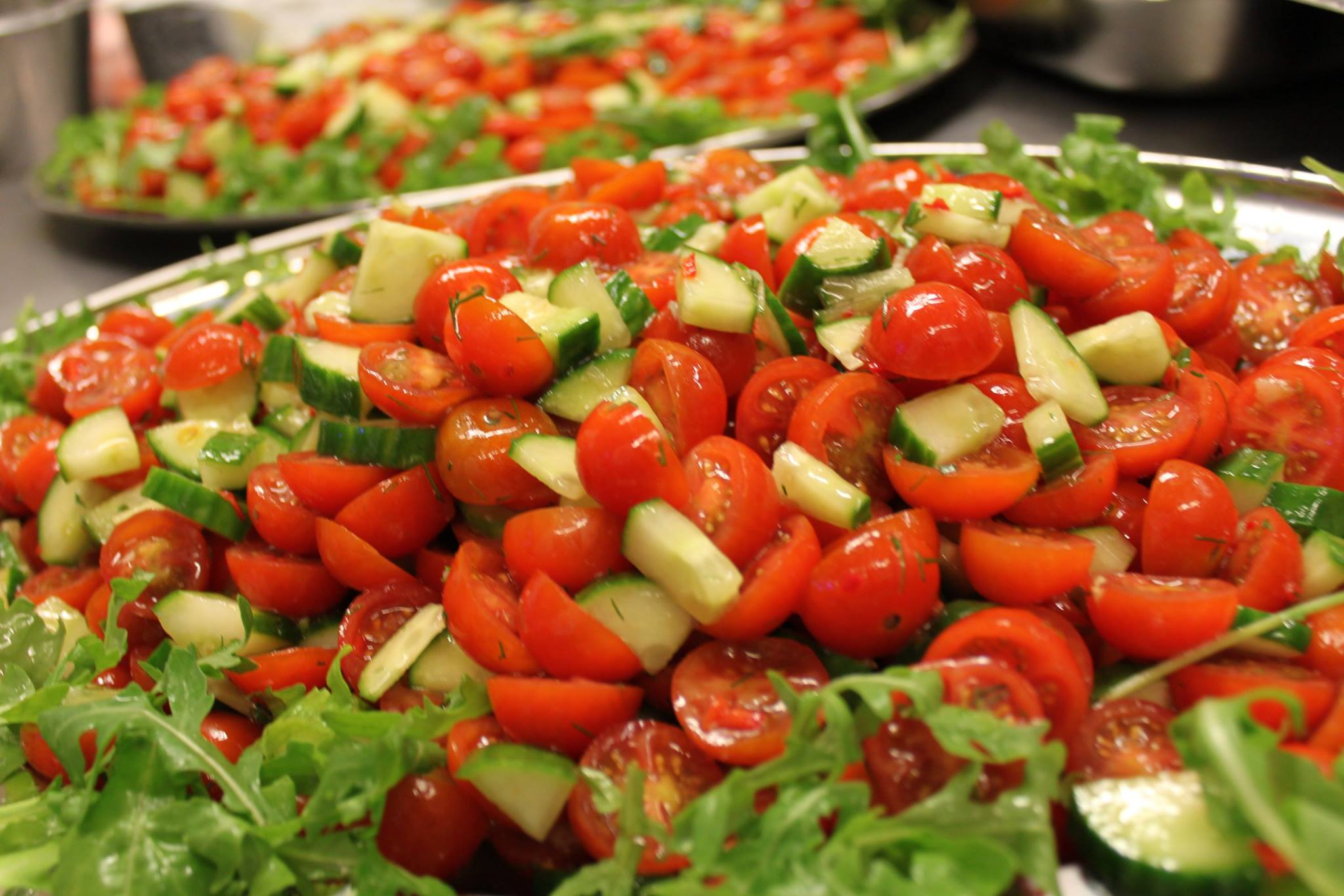 Cherry tomatoes diced cucumbers in a dill dreessing