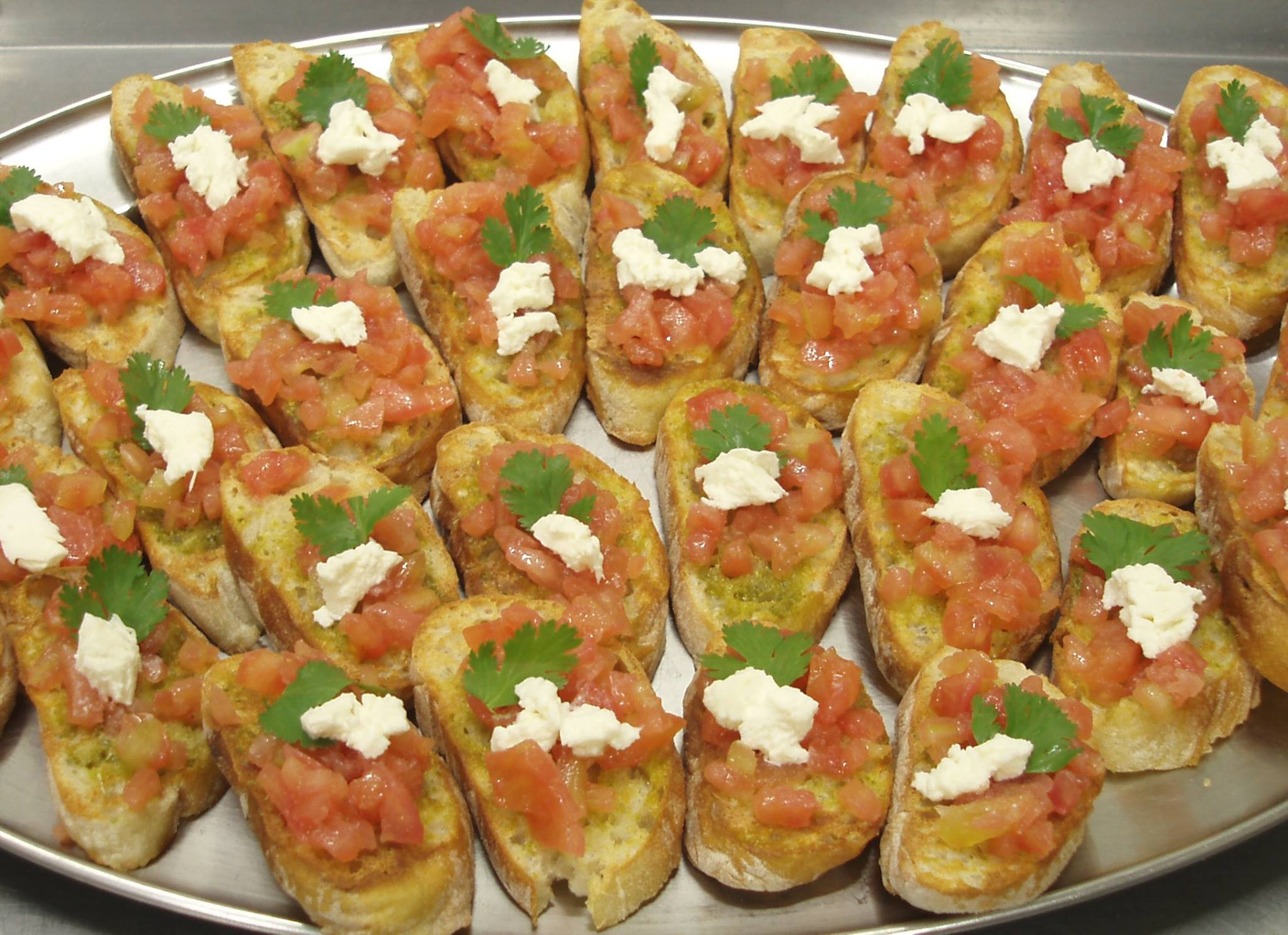 Bruschetta's rubbed with garlic topped with seasoned tomato concasse topped with cream cheese.