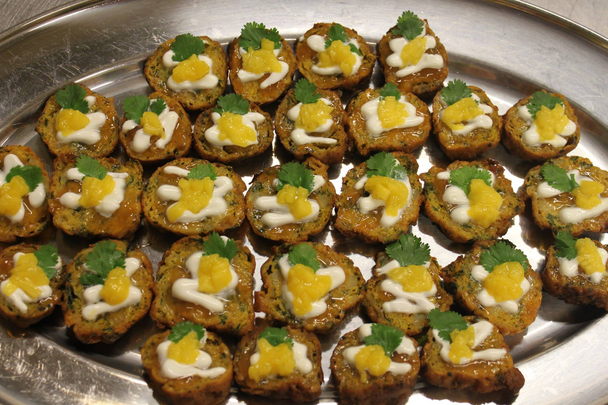Onion barghis, yogurt and mango canapes